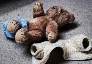Stripped teddy on concrete floor