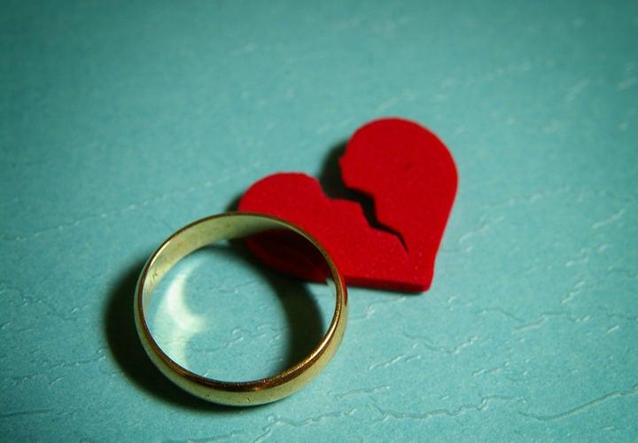 wedding ring and broken red heart - divorce concept