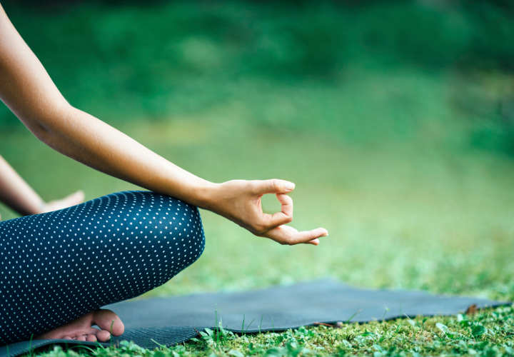 Yoga detail, lotus position mudra
