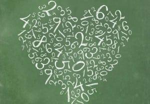 Seamless pattern: simple numbers on blackboard background