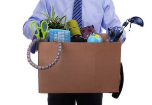 Unemployment concept, fired man with personal items in a box