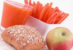 light breakfast - roll apple juice and fresh carrots