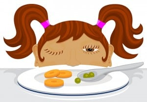 Girl deciding if she should eat her vegetables