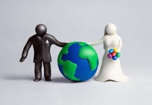 Black&white plasticine human figures playing a role of bride and groom