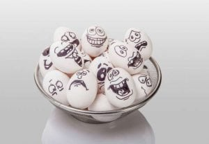 Different expression of funny eggs in basket