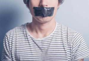A young man has a big piece of black industrial tape covering his mouth