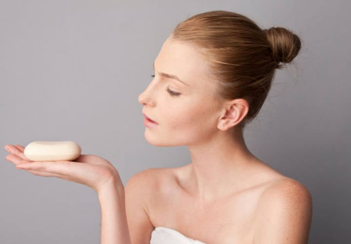 woman using a soap bar