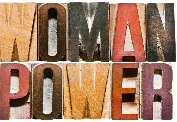 The words WOMAN POWER spelled out with vintage letterpress wood block letters.