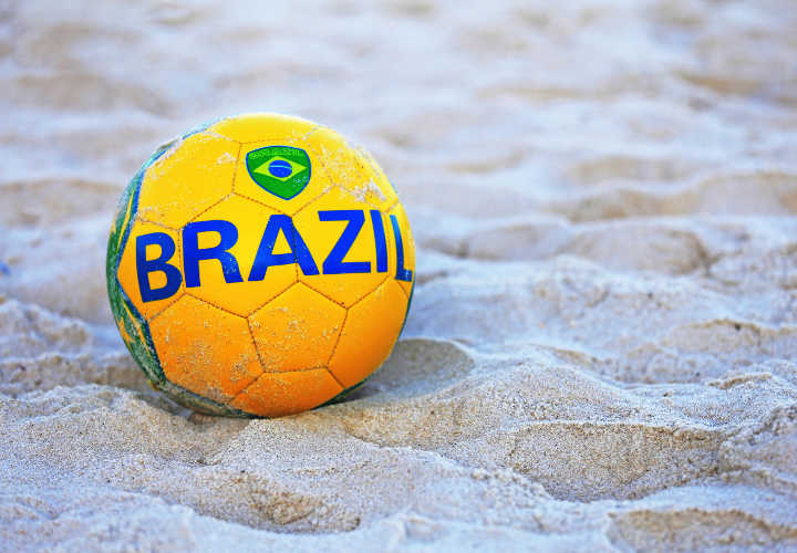 Football with the flag of Brazil at Copacabana Beach, Rio de Janeiro, Brazil