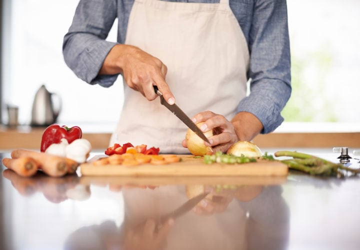 Cropped shot of a man chopping up some vegtables