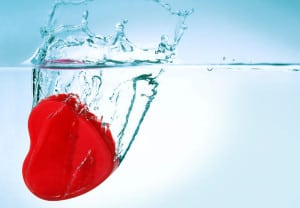 red heart sinking in water closeup