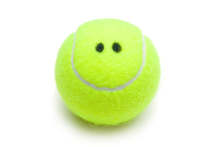 Smiling tennis ball on white background. Fun Fun.