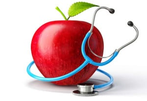 concept red apple with stethoscope on white