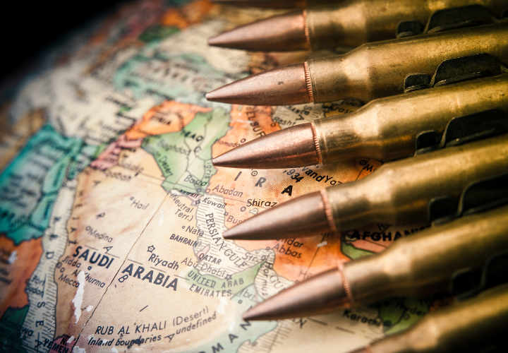 Map of the Middle East with Saudi Arabia in focus with bullets draped across