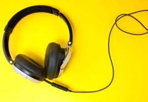 modern style headphones shot on a yellow background