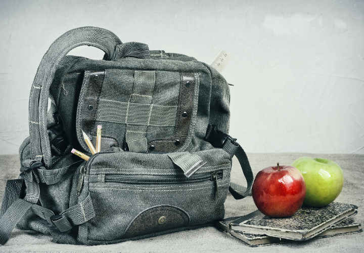 Still Life With An Old Backpack, Books And Apples