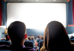 Group of people at the cinema watching a movie