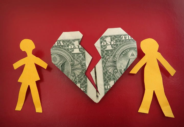 paper couple on broken dollar heart