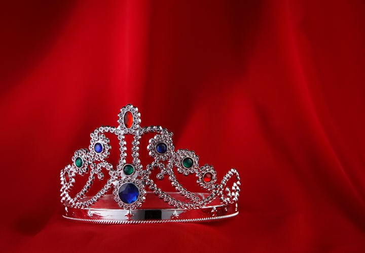 Tiara with a red cloth as background.