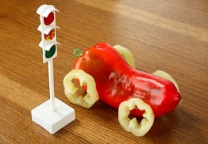 Health concept. Traffic light and car from pepper