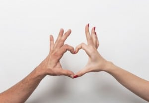 Couple hands making heart gesture