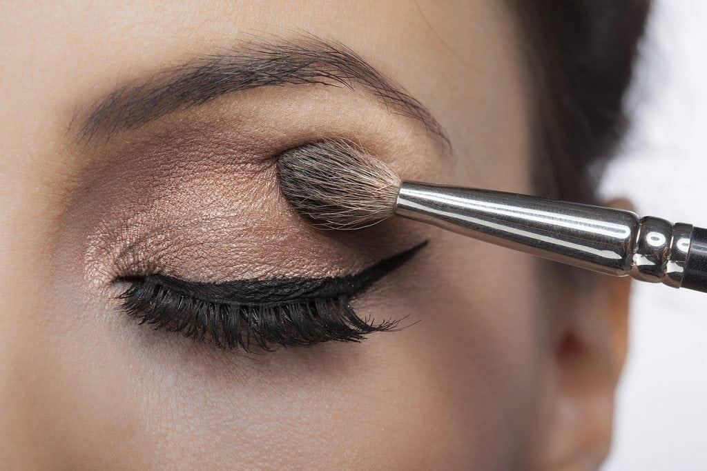Makeup close-up. Eyebrow makeup, long eyelashes, brush