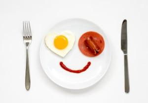 Top view ; Smile for sweet breakfast with fork and knife on white background