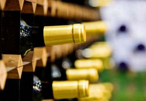 Group of wine bottles on rack.
