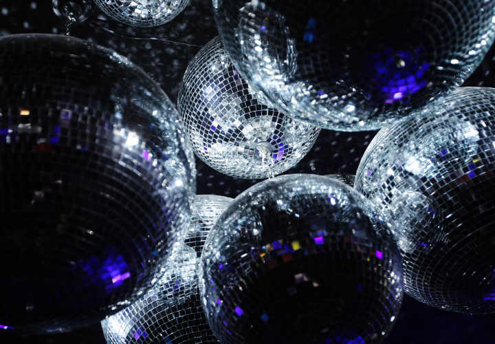 Set disco balls suspended on a ceiling in a night club