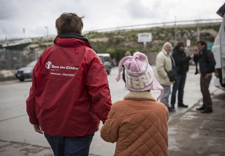 Save the Children staff accompanies Ayana*, 10, at the docks in Lampedusa as she prepares to board a ferry going to Sicily where she will travel along with 90 other migrant children to begin a long-term process of integration into Italian life. Since the beginning of 2015, migrants have been arriving by boat from Libya in their thousands, including women, accompanied and unaccompanied children. Many of these migrants are fleeing persecution and violence in hope they will find a better life in Europe.