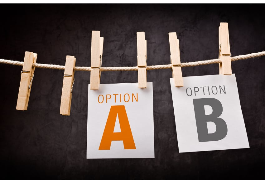 Concept of choice between two options marked as A and B. Letters are printed on note paper and attached to crope with clothes pins.